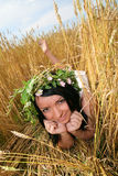 Girl in a field. Girl in the field lies on the ripe ears of wheat Stock Photo