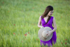 Girl on field. Young beautiful girl feeling freedom on meadow Royalty Free Stock Photography