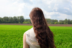 Girl in the field Stock Photo