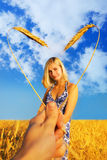 Girl in the field. Beautiful girl standing in the wheat field and heart shaped border around her Stock Images