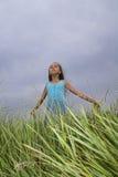 Girl on field Stock Image