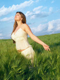Girl in field Stock Images