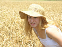 Girl in field. Field of Wheat royalty free stock photography