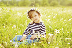 Girl in field in backlit Royalty Free Stock Photography