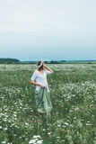 A girl in a field of chamomiles Stock Image