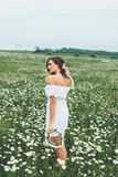 A girl in a field of chamomiles Royalty Free Stock Photography