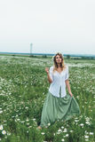A girl in a field of chamomiles Royalty Free Stock Images