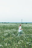 A girl in a field of chamomiles Royalty Free Stock Photos