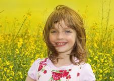 Girl on a field with colza Royalty Free Stock Photo