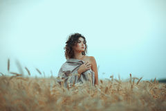 Girl in  field covered with a cloth. Royalty Free Stock Images