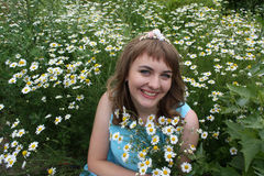 Girl in the field with daisies Stock Photos