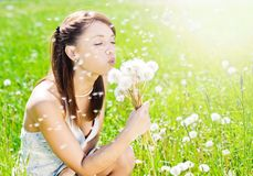 Girl on field with dandelion Royalty Free Stock Images