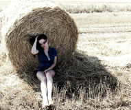 Sexy woman in denim suit in the straw field Stock Photos