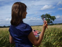 Girl in a field drawing Stock Photo