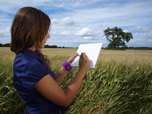 Girl in a field drawing Royalty Free Stock Image