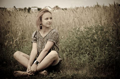 Girl in the field on a farm Stock Photography
