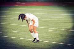 Girl in the field. Female  playing football on a soccer game Stock Photo