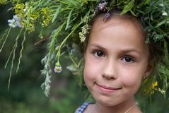 Girl in field flower garland Royalty Free Stock Photo