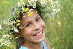 Girl in field flower garland Stock Images