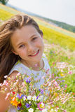 Girl in the field of flowers Stock Images
