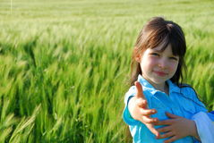 girl in a field of grain Royalty Free Stock Image