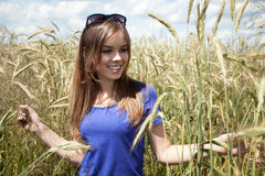 Girl among field of grain Stock Photography