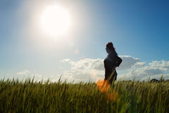 Girl in field of grass Stock Photography