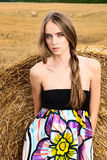 Girl in a field with haystacks Royalty Free Stock Photography