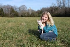 Girl In A Field With Her Dog 2 Royalty Free Stock Photo
