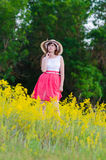 Girl in the field Royalty Free Stock Image