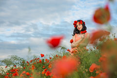 Girl in a field of poppies Stock Photos