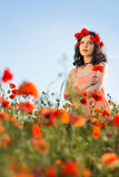 Girl in a field of poppies Stock Images