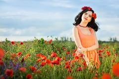 Girl in a field of poppies Stock Photo