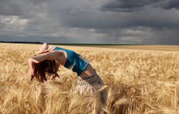 Girl at field in rainy day Stock Image