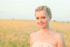 Girl in a field with spikelets. In the sunning day Stock Images