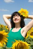 Girl in the field of sunflowers Royalty Free Stock Photo