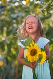 The girl in the field of sunflowers. Girl in the field of sunflowers royalty free stock photos
