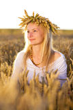 Girl in the field at sunset Royalty Free Stock Photography