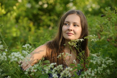 Girl in a field of tall grasses Royalty Free Stock Photos