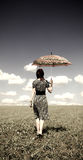 Girl at field with umbrella. Retro style Stock Images