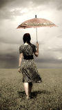 Girl at field with umbrella. Photo in retro style Royalty Free Stock Photos