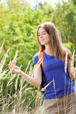 Girl on a field of wheat Royalty Free Stock Image