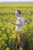 The girl in the field of wild flowers Stock Photos