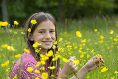 Girl (7-11) in field of wild flowers, smiling Royalty Free Stock Photo
