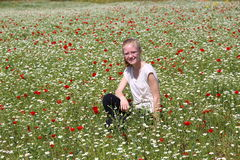 Girl on a field with wildflowers Royalty Free Stock Image