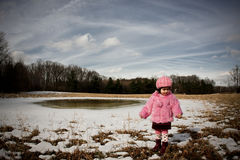 Girl in a field6. Girl walking in big field during winter Royalty Free Stock Image