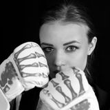 Girl in boxing gloves, black and white image. royalty free stock photos