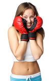 Girl in fighting gloves Royalty Free Stock Images