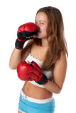 Girl in fighting gloves Royalty Free Stock Photo