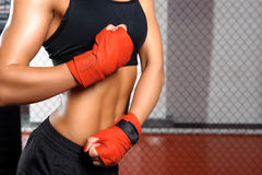 Girl fighting in a ring Stock Photography